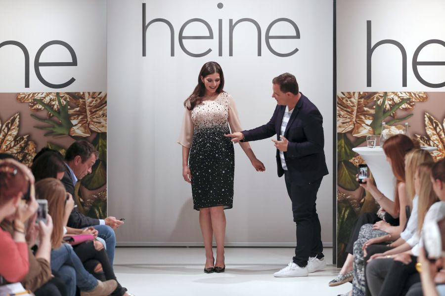 HAMBURG, GERMANY - JUNE 09: German fashion designer Guido Maria Kretschmer and his model during the Guido Maria Kretschmer presents new collection by heine on June 09, 2016 in Hamburg, Germany. (Photo by Franziska Krug/Getty Images for heine)